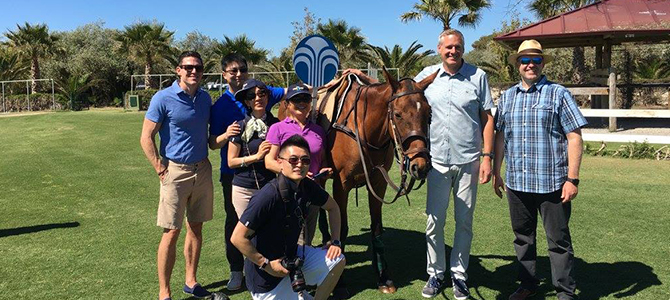 Nu Skin Sales Leaders, Blake Roney, and Ryan Napierski pose for a picture with a donkey at the Santa Maria Polo Club. title=