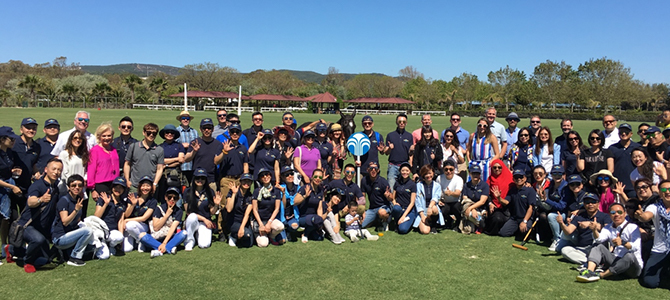 Nu Skin sales leaders and Nu Skin management pose for a picture at the Santa Maria Polo Club.